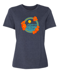 Women's navy blue crew-neck short-sleeve t-shirt with circular West Coast sunset over beach and orange poppy flower design