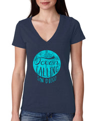 Women's navy blue v-neck short-sleeve t-shirt with circular turquoise print and The Ocean Is Calling San Diego verbiage