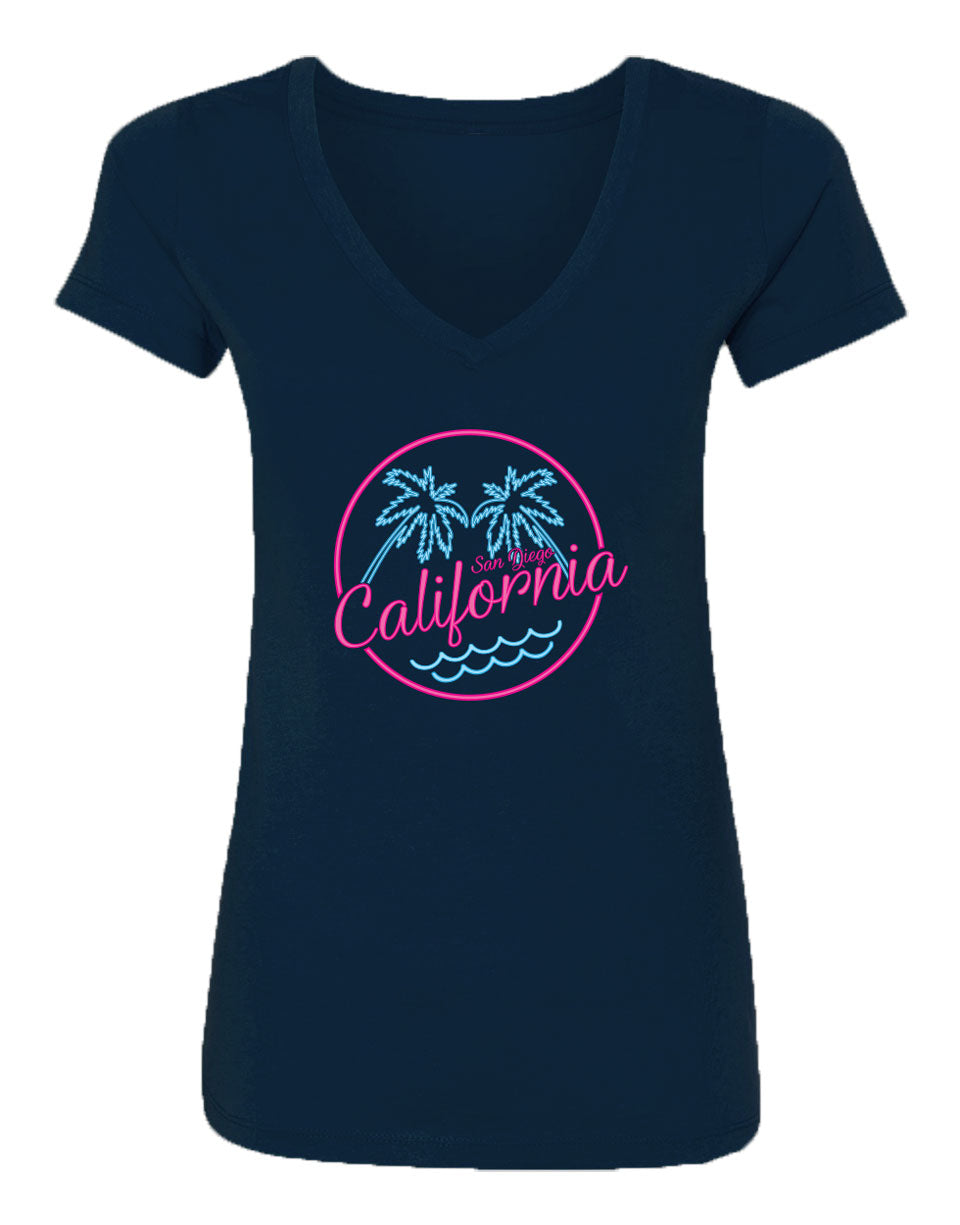 Women's navy blue v-neck t-shirt with bright neon pink and blue beach palm tree circular design and California script verbiage