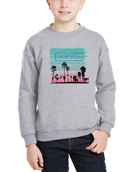 Youth heather gray crewneck kids sweatshirt with turquoise and pink sunset glow print palm tree silhouette chilling in cali