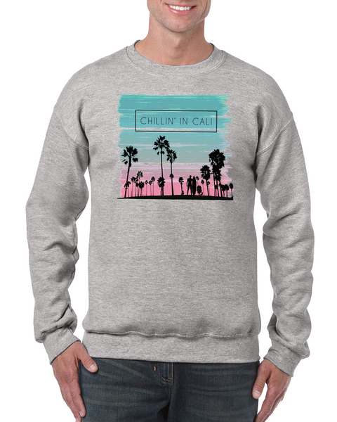 Adult Men or Women Unisex graphite heather gray crewneck adult sweatshirt with turquoise and pink sunset glow graphic print palm tree silhouette chilling in cali