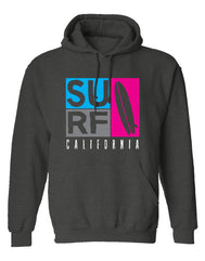 Men or Women Unisex Adult comfortable soft hoodie sweatshirt  in black with adjustable draw strings and kangaroo front pockets. Design is by local artist in San Diego, California. Surf California Graphic Hoodie. Sold by San Diego Trading Company. Vibrant blue, pink, gray blocks with the word SURF and tall surfboard beautifully silkscreen printed. Text at bottom California in white letters.