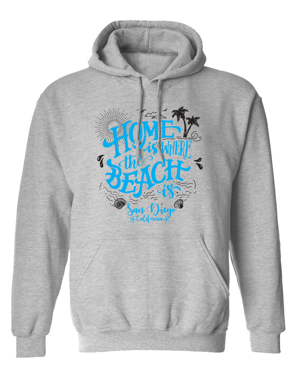 Men or Women Adult comfortable and relaxing hooded sweater in oxford gray with adjustable draw strings and kangaroo pockets. Design is by local artist in San Diego, California. Light ocean blue printed Home is Where the Beach is San Diego, California  Graphic Hoodie. Sold by San Diego Trading Company.