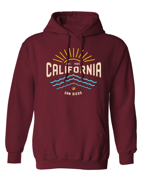 Men or Women Unisex Adult hoodie sweater.  Custom design and printed in the city of San Diego, California by local artist. Beautiful sunrise and beach waves design on a cardinal burgundy hooded sweater. Comes in Small through Double X-Large. Sold by San Diego Trading Co.