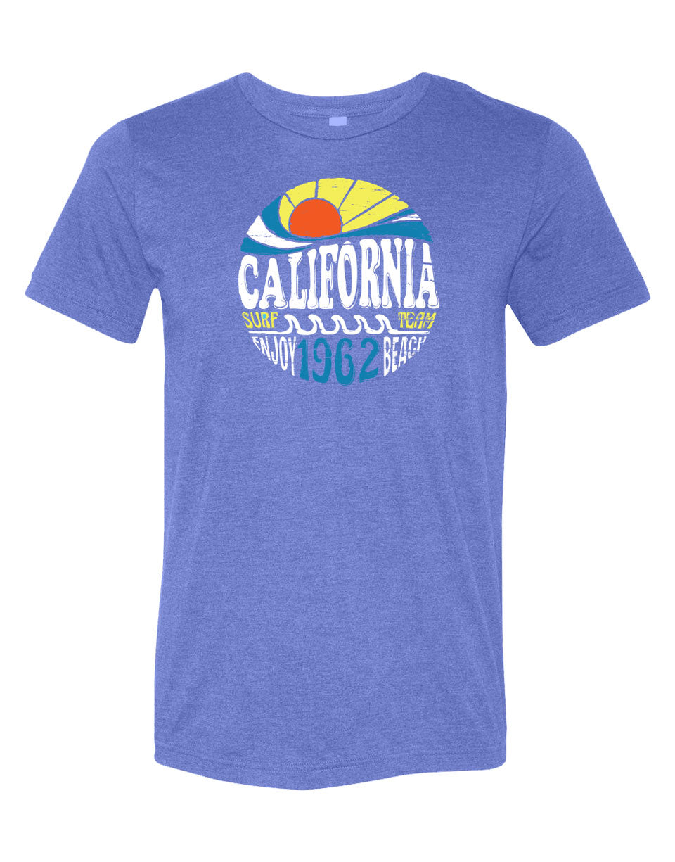 Heather Royal short sleeve adult tee with California surf team enjoy beach 1962 verbiage in a circle with a sun and waves design