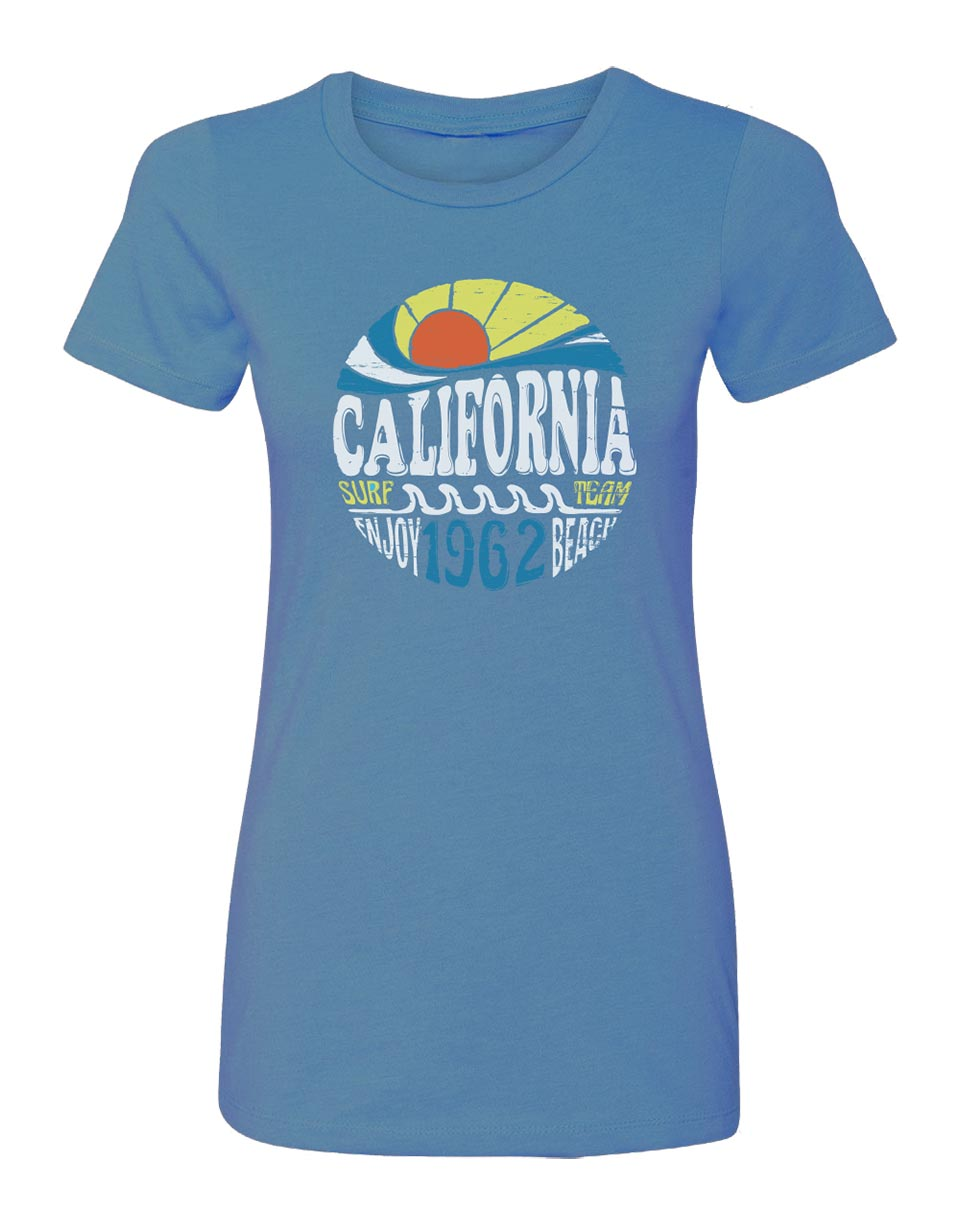 Women's light blue crew-neck t-shirt with circular design with sun, beach, waves and California surf team enjoy beach verbiage