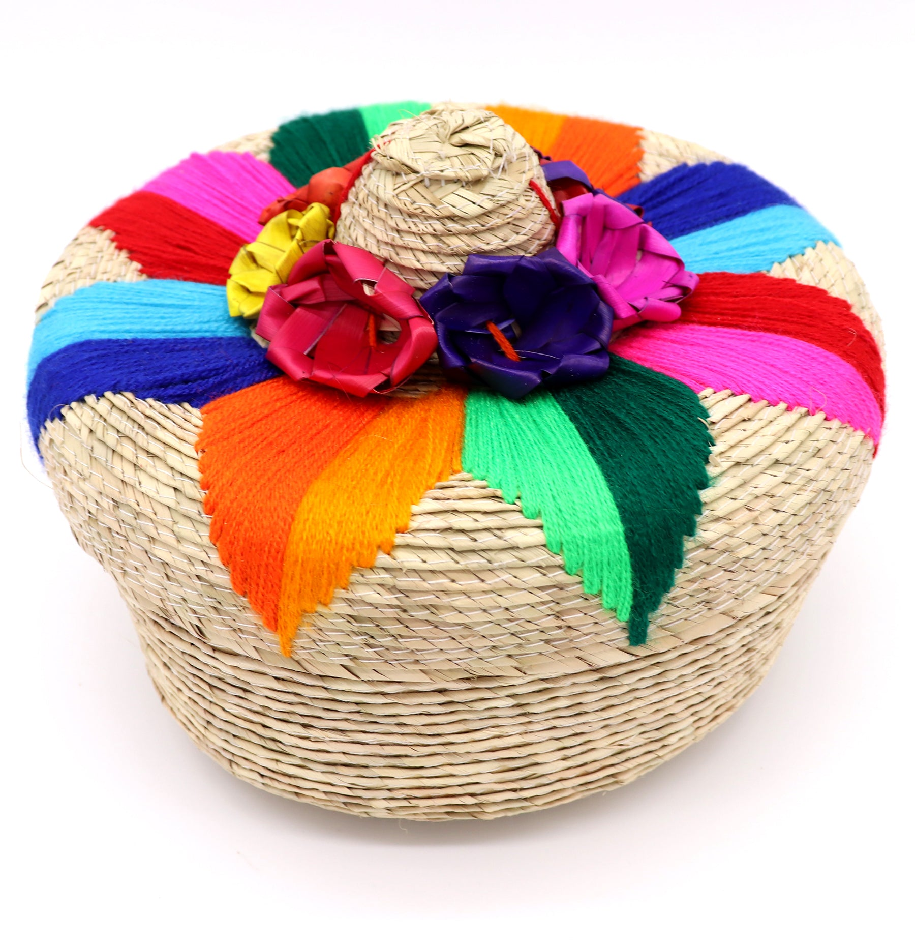Handwoven basket for decoration or keeping your tortillas warm. Made with natural palm or corn husk materials. Handcrafted with yarn to make flower design on top. Made in Mexico. Basket is perfect for food such as warm corn tortillas or small crafts such as puzzles, bows, or any household items. Sold by SDTrading Co.