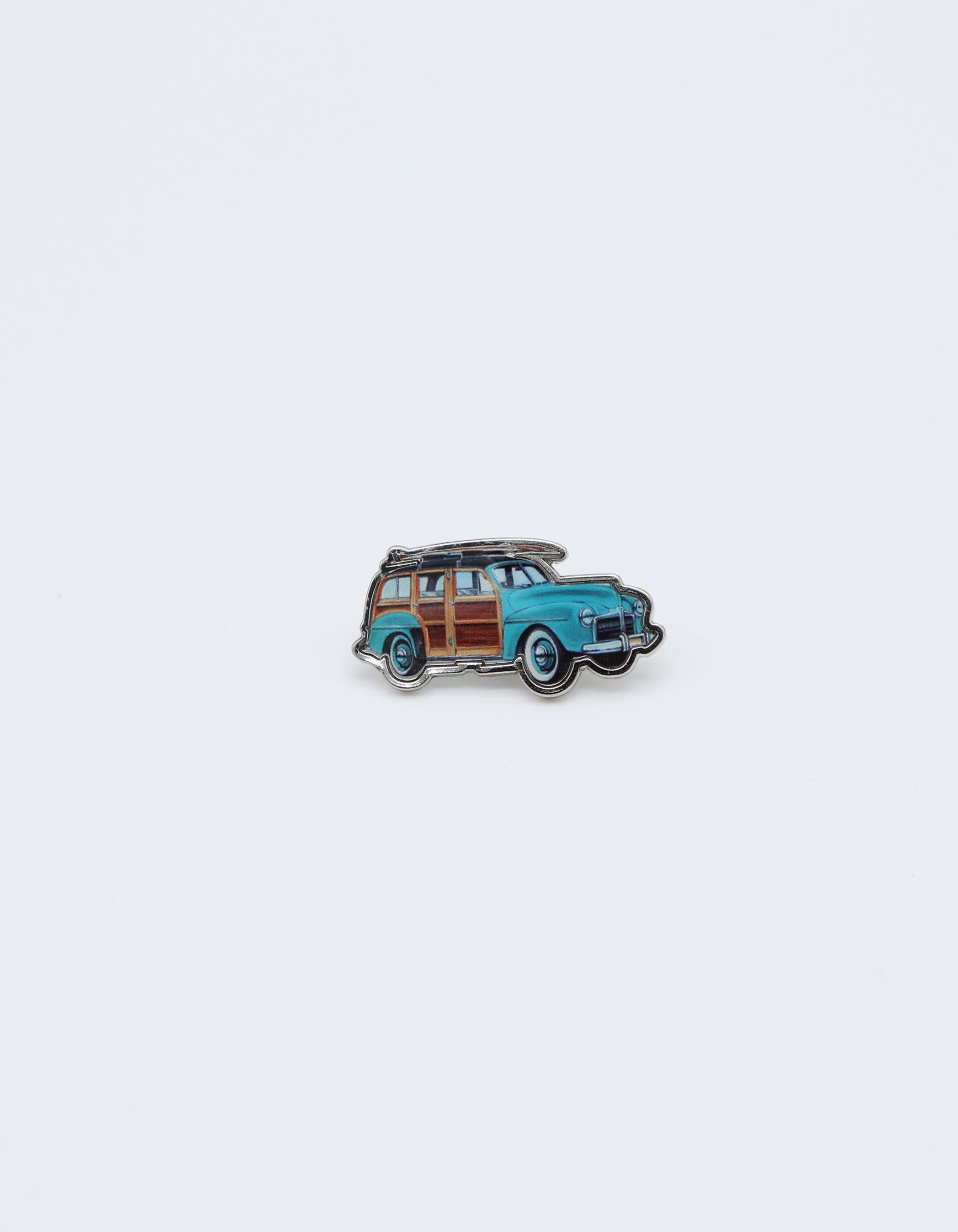 Station Wagon Pin. Sky blue 1947 Woody vintage wagon Car Pin with a surfboard on top. Design and sold my small local shop SDTrading Co.