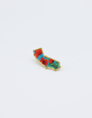 California State Metal Epoxy Pin featuring three poppy flowers with a sky blue background