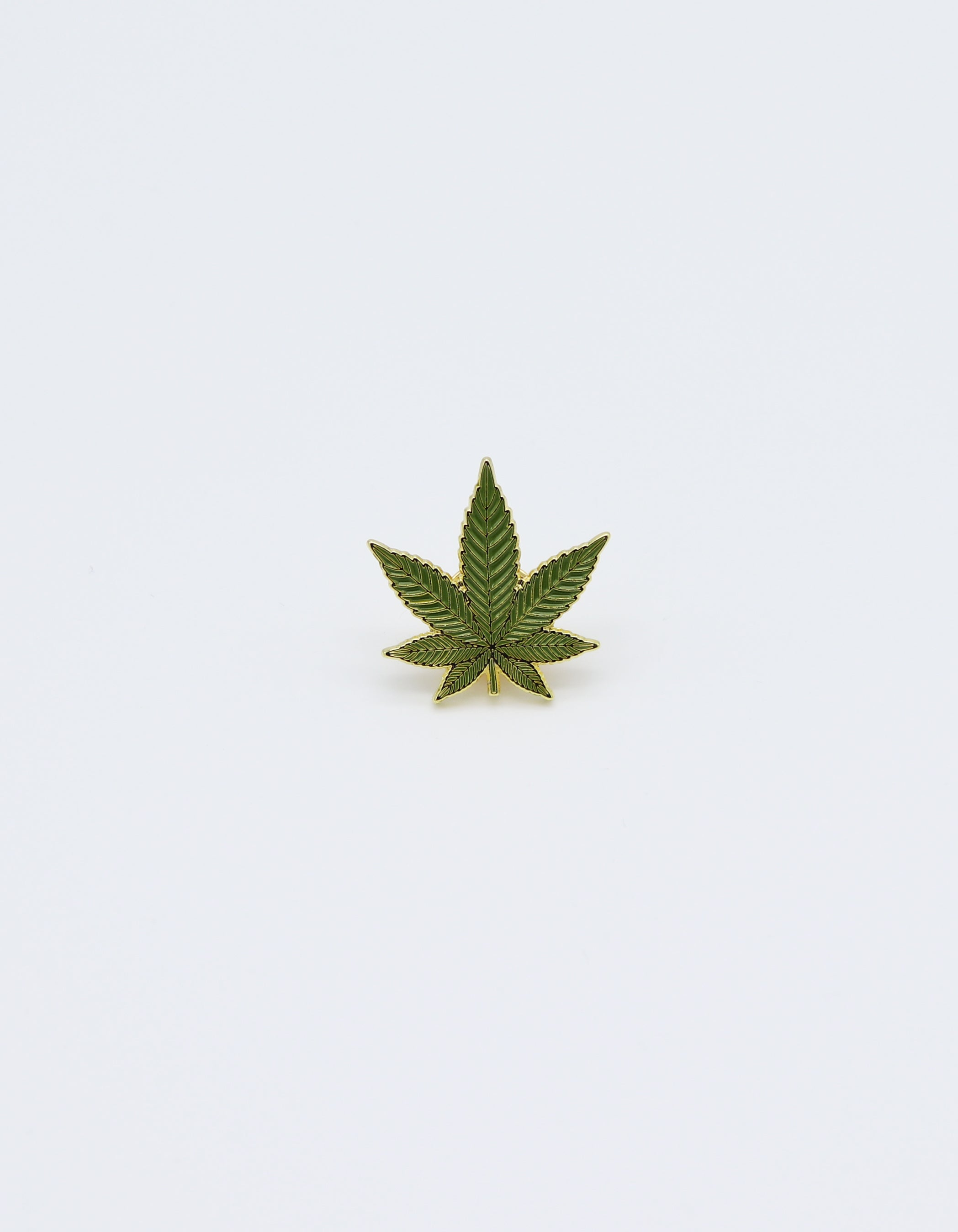 Marijuana leaf pin. Cannabis Leaf  pin green colored with Gold painted Trim. Metal Label Pin accessory.  Beautiful fun accessory that can be placed on a hat, beanie, jacket, backpack or anywhere to elevate your look. Design by local shop SDTrading Co.