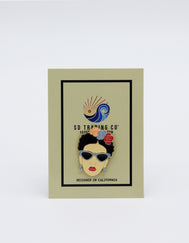 Enamel metal pin of Iconic Mexican artist Frida Kahlo wearing teardrop earrings and cat eye sunglasses