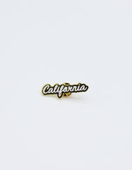 Gold colored California cut out enamel pin with CA in white