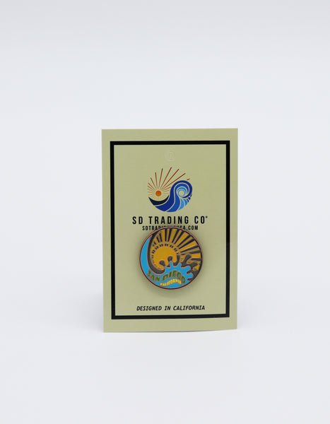 Circle Bronze pin of Yellow Sun and a Blue splash of water with verbiage San Diego filled with green and California in yellow