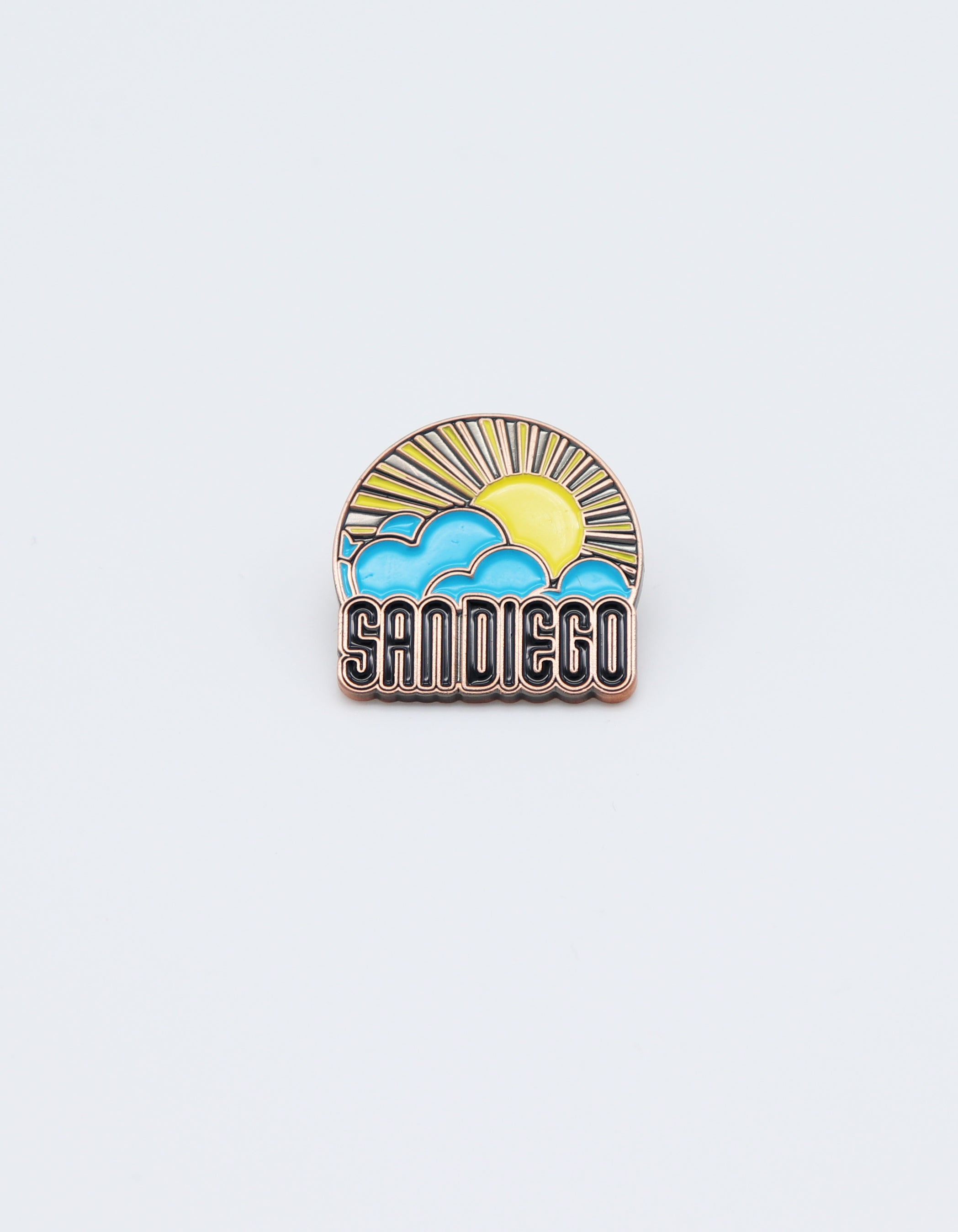 Bronze Sun and Clouds metal enamel pin in yellow and sky blue with verbiage San Diego in black fill letters