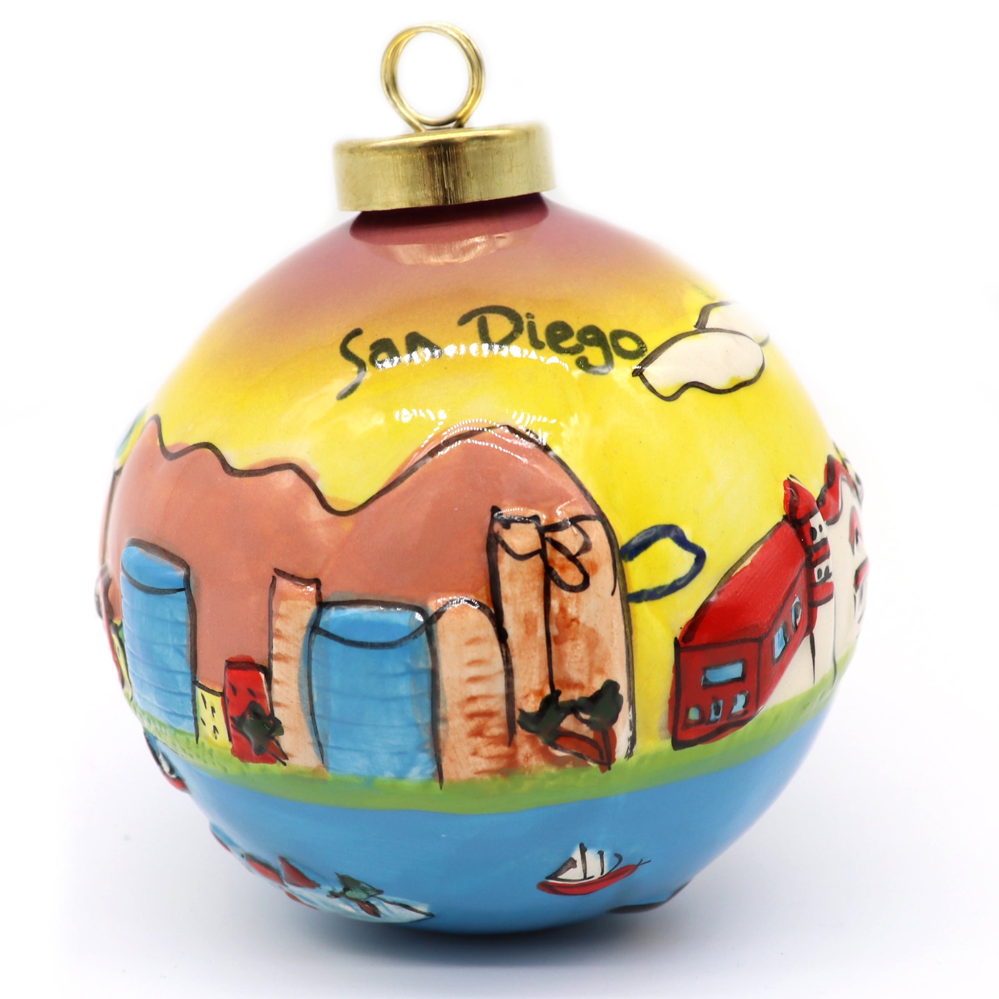 San Diego Ornament for Christmas tree. Ceramic painted downtown buildings and water front marina with boats. San Diego printed in black on top of the yellow sun skyline. Gold clasp loop for hanging. Sold by SDTrading Co.