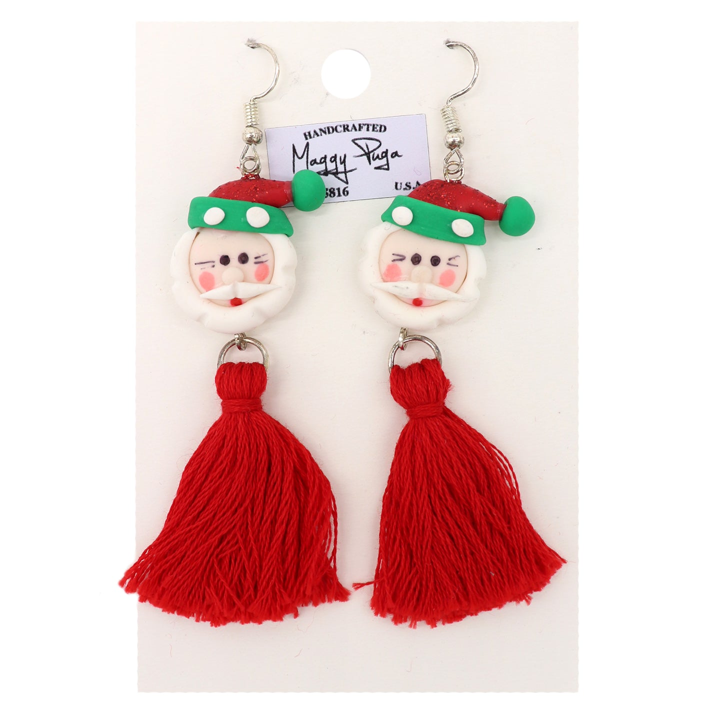 Christmas holiday earrings. Featuring Santa Claus with a red and green hat, white beard, blush cheeks , and red tassels. Handcrafted by small shop Maggy Puga and Sold by SDTrading Co.