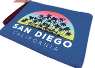 Women wallet clutch coins, keys, bills, passport or any traveling souvenirs your heart desires. Beautiful blue wallet with design of palms black silhouette and half circle rainbow background with text at bottom San Diego, California. Zipper closure with brown pull handle.