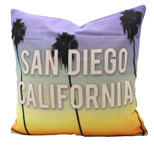 Pillow Cover of San Diego, California. Beautiful sunset design of palm trees, blue sky top, and yellow sunset color at bottom with white middle text San Diego, California. Great for sofa couch, bedroom bed, or accent chair decor.