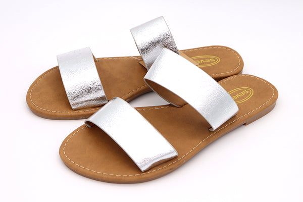 Side view of Women's silver double Strap Slip sandal with shine in faux leather material soft to the touch in sizes 5-10