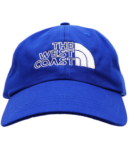 Unisex men or women The West Coast baseball hat. Embroider north face like symbol of half rainbow on solid royal blue cap. Great for traveling, camping, fishing, summer, outdoor activities. Fathers, son, or uncle's gift.