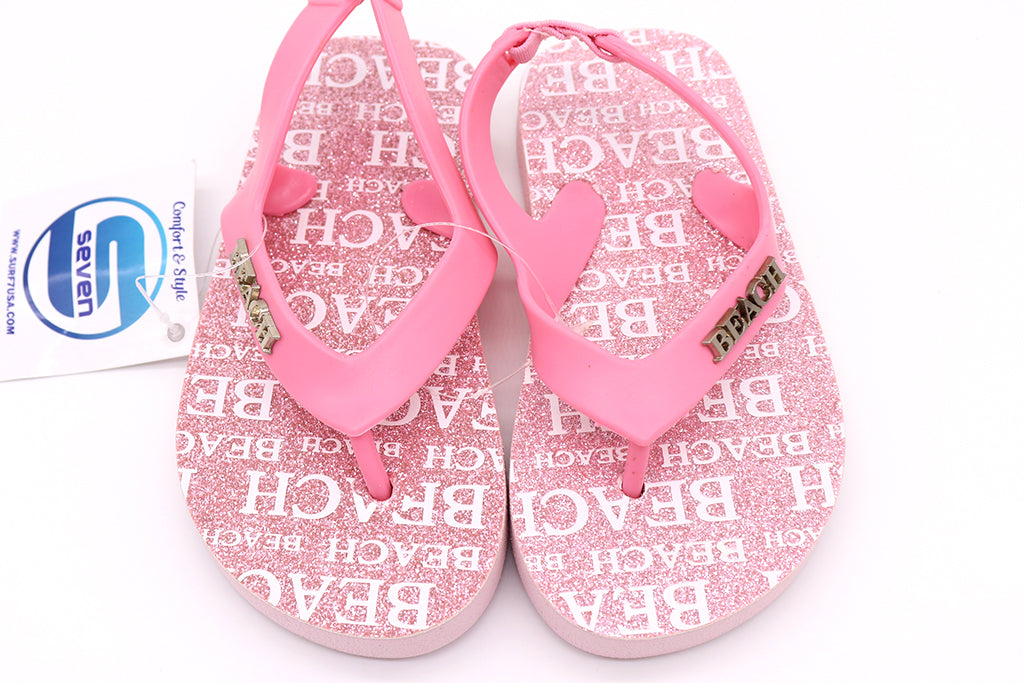 Toddler girl sandals thong slip on with backing to keep on tiny tots feet. Shoes for beach, pool, lake, and or summer. Come in color pink with a silver beach plate on the upper right strap. The bottom of the soles are printed with multiple beach wording in white. Sold by SDTrading Co.