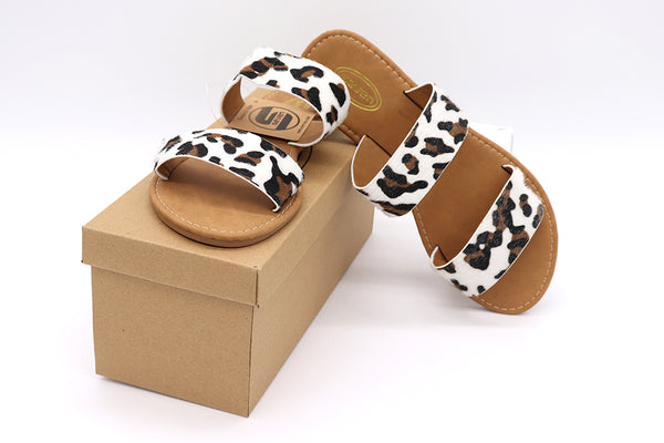 Cheetah sandals, women shoes, women sandals, flat sandals, cheetah print brown and black spots on a white furry material, double strap slip on sandals. Faux vegan material hair like fibers. Women Sandals. Size 5, Size 6, Size 7, Size 8, Size 9, Size 10 Sandals.