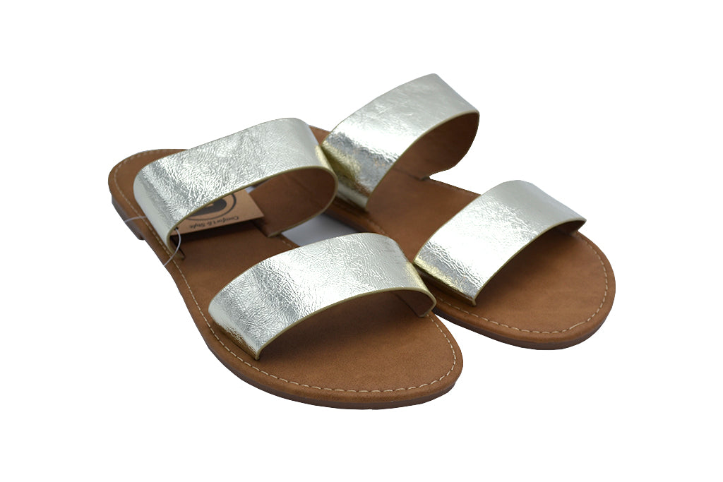 Gold Sandals Women. Double Strap flat sandals. Side view of Women's black double Strap Slip sandal in faux leather or pleather material soft to the touch and real leather look. Sizes 5, Size 6 Size 7, Size 8, Size 9, Size 10. Gold Flip Flops.