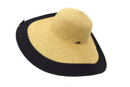 Side view of Women's beach hat, floppy hat with large rim with UV protection from sun. Great summer hat, vacation hat, or everyday hat. Ladies, teen or anyone can wear. Beautiful straw color with black outer rim. Lucky 7 tag.
