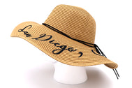San Diego, California Women's beach hat, floppy hat with large rim that has great protection from sun. Great summer hat, vacation hat, or everyday hat. Beautiful straw sand color with decorative black strings all around and elastic band inside to keep hat on.