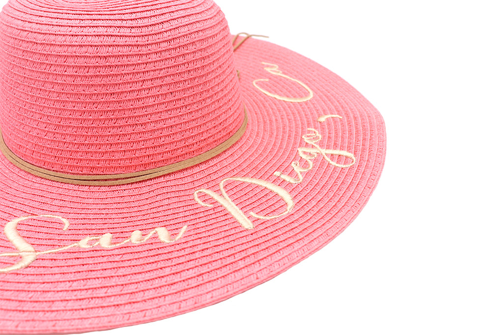 Women's beach hat, floppy hat with large rim that has great protection from sun. Great summer hat, vacation hat, or everyday hat. Beautiful pink color with decorative strings all around and elastic band inside to keep hat on. San Diego, Ca. in large gold letters on top of hat.