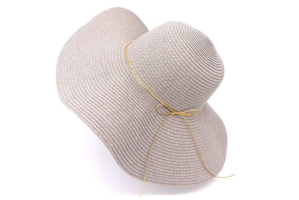 Side view Solid grey Women's beach hat with decorative strings, floppy hat with large rim that has great protection from sun. Great summer hat, vacation hat, or everyday hat.