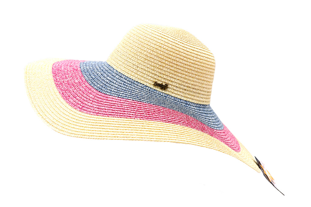 Side view of Women's beach hat, floppy hat with large rim that has great protection from sun. Great summer hat, vacation hat, or everyday hat. Beautiful multi color natural straw, blue and pink with elastic band inside to keep hat on.