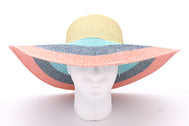 Women's beach hat, floppy hat with large rim that has great protection from sun. Great summer hat, vacation hat, or everyday hat. Beautiful multi color khaki top, and rows of turquoise, blue, and pink with an elastic band inside to keep hat on. Sold by SDTrading Co.