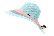 Side of Women's beach hat, floppy hat with large rim that has great protection from sun. Great summer hat, vacation hat, or everyday hat. Beautiful multi color turquoise, pink, blue and turquoise rim with elastic band inside to keep hat on. Vacation hat for women to travel comfortably.