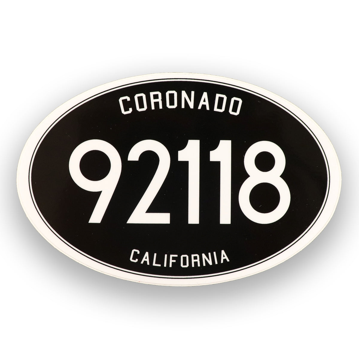 Coronado California Sticker. Classic black and white 92118 sticker. Black oval with Coronado white letters above and 92118 number in the middle and California on the bottom. Sold by SDTrading Co.