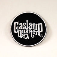 Black cotton patch lined with white stitching  and the Gaslamp Quarter Logo in white for t-shirts, jackets, backpack or any material to sew on to