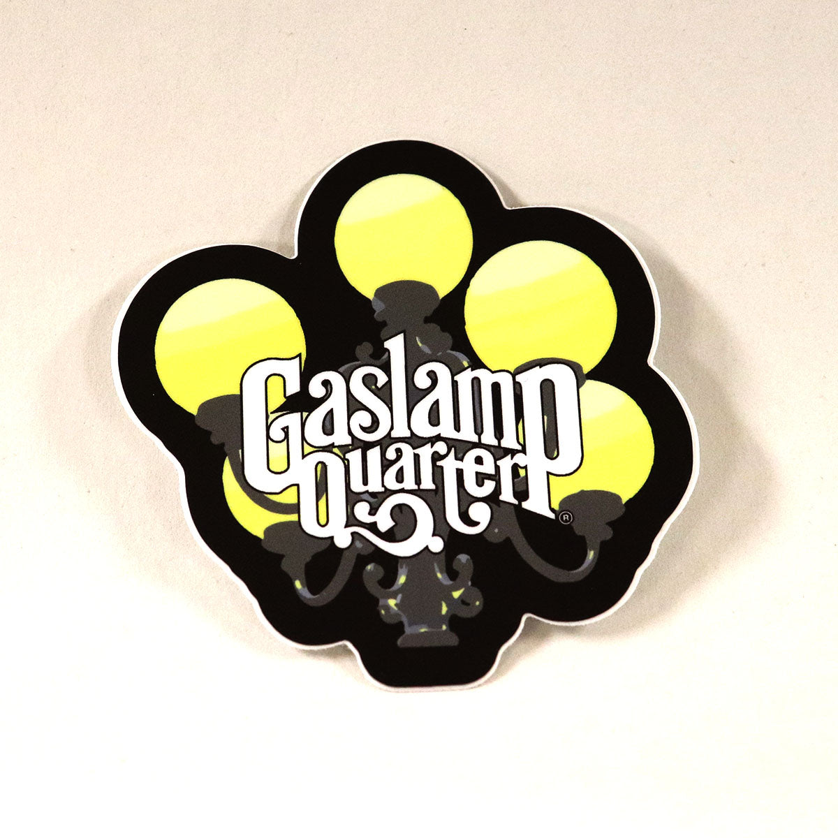 Sticker of a full color Gaslamp with the Gaslamp Quarter logo placed in the middle in white letters