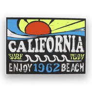 California Surf Sticker. Groovy 1962 beach team surf sticker. Nice stenciled sun in orange and yellow with blue wave lines. Bubbly California white text and Enjoy Beach. Yellow surf team wording and 1962 numbers in blue. Retro sticker for surfers. Sold by SDTrading Co.