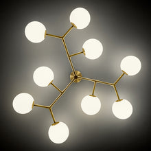9 arm constellation brushed brass pendant light - light detail