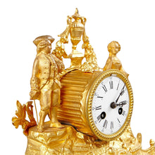 Mantel clock in gilt - figures