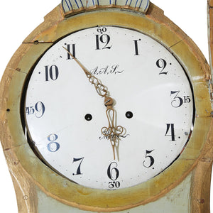 mora clock with initials and town