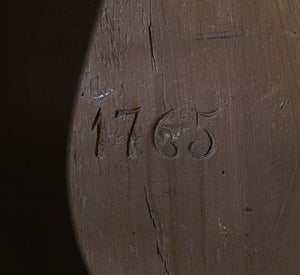 1765 carved into the body of this mora clock