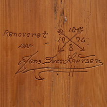 Mora clock carved detail of renovation date