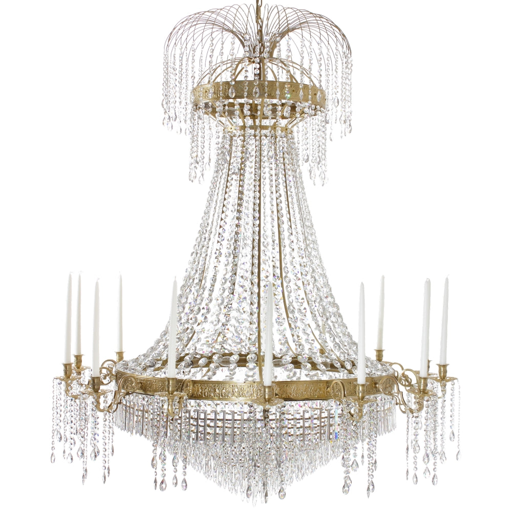 Polished brass Empire style chandelier with 14 arms and crystal octagons