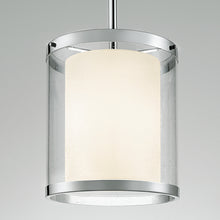 Polished chrome light with an outer seed glass shade - details