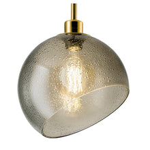 Brushed brass light with smoke coloured glass