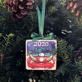 "2020 USA Blue Crab w/ Face Mask, Wooden 3x3"" Holiday Ornament with Green Ribbon hanging on tree"