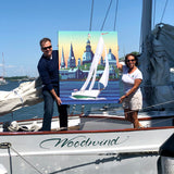 Holding this canvas is Artist Joe Barsin and Woodwind Captain Jenn Kaye
