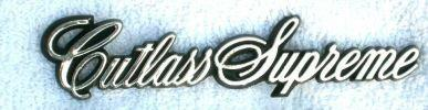 FENDER EMBLEM (CUTLASS SUPREME) 82-88, GLUE ON SCRIPT, USED