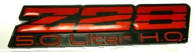 DASH EMBLEM, (Z28) 82-92 CA (5.0 LITER HO) RED, USED